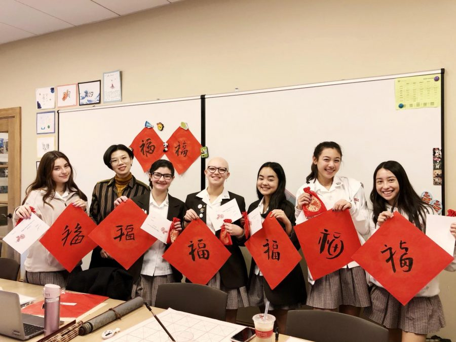 Ms.+Zhang%27s+Mandarin+II+class+showcase+their+calligraphy.+