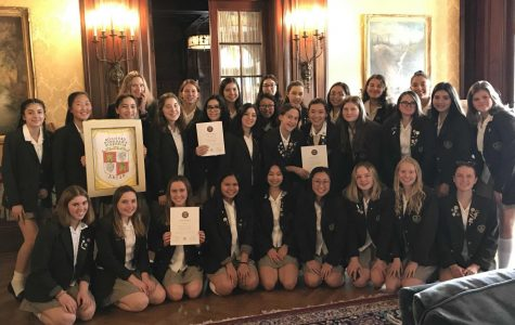 Newly inducted members of Mayfield's chapter of the Spanish National Honor Society pose for a picture in Strub Hall.