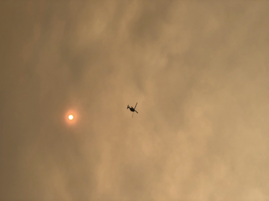 Smoke from the Bobcat Fires covers the sky and makes the sun glow orange.