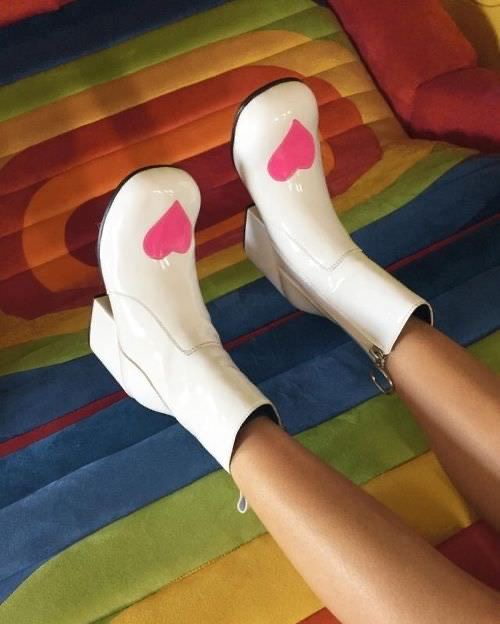 Person wearing Moxie Heart Boots from UNIF Clothing.