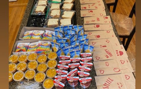 Gabrielle Owen '21 lays out all the food she will put into the bags for Union Station.