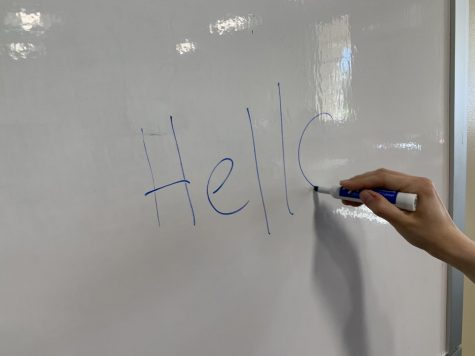 Don't turn away from this lonely whiteboard... throw a little pizazz on his face with some marker.
