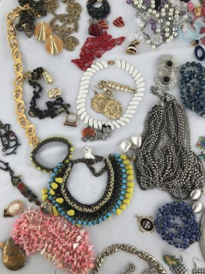 A full table covered with second hand jewelry.