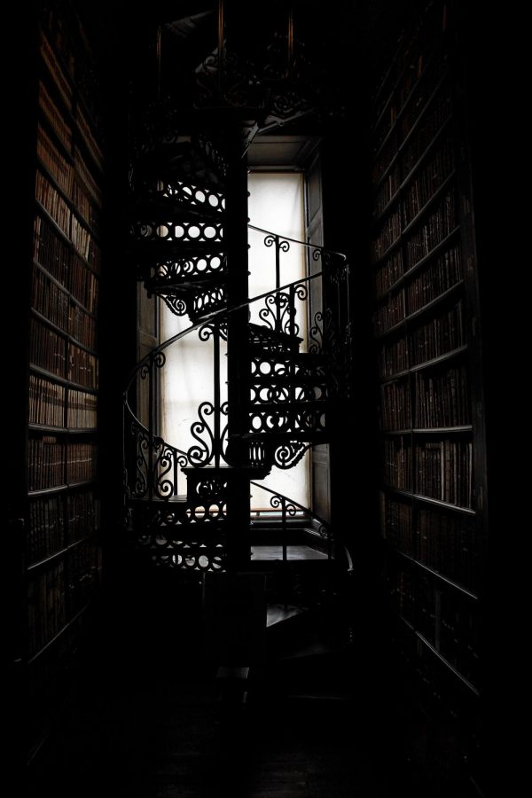 Silhouette of a library staircase. Photo from Pixabay and Pexels, Free to use (CC0).